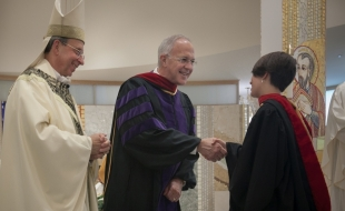 Archbishop William E. Lori was joined by Carl Anderson in presenting the graduates with their academic hoods.